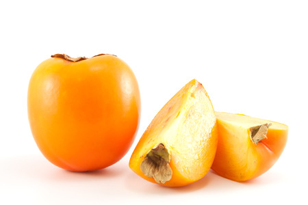 Orange fresh organic persimmon on white background Stock Photo