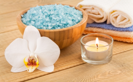 Towels, orchid, candle, sea salt for Spa Treatment