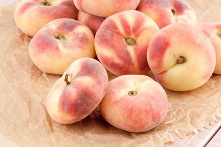 Saturn peaches or chinese flat peaches photo