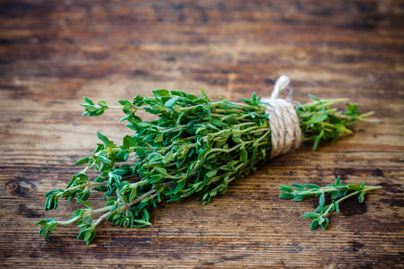 bunch of fresh organic thyme on a wooden background Reklamní fotografie