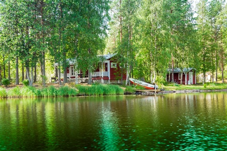 Cottage by the lake in rural Finland photo