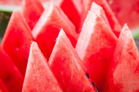 seedless: slices of fresh juicy organic watermelon closeup on a wooden background Stock Photo