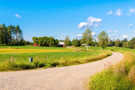 iowa agriculture: red houses in a rural landscape in Finland