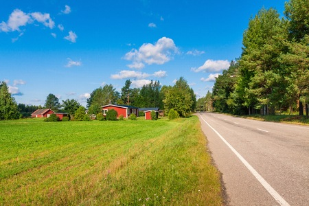 red houses in a rural landscape in Finland photo