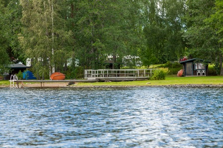 Summer cottage by the lake in rural Finland photo