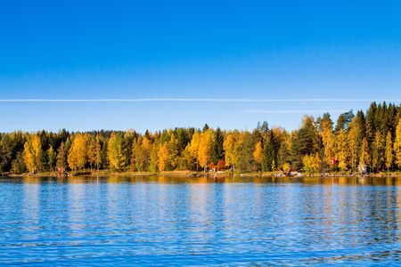 Fall colors reflected in a smooth lake photo