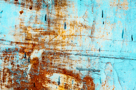 Old rusty blue wall as background photo