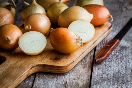 red onion: Fresh organic onions on a wooden background