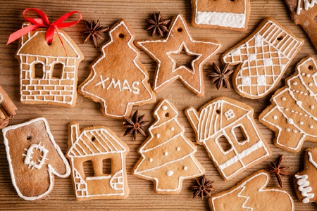 Gingerbread Cookie on a rustic wooden background photo