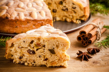 Dundee cake on an old rustic wooden table