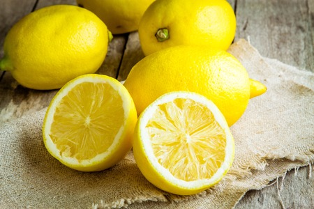 no way out: Fresh juicy lemons on a rustic wooden background Stock Photo