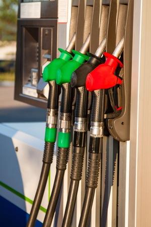 fuel pumps: Red, green and black fuel pumps at petrol station