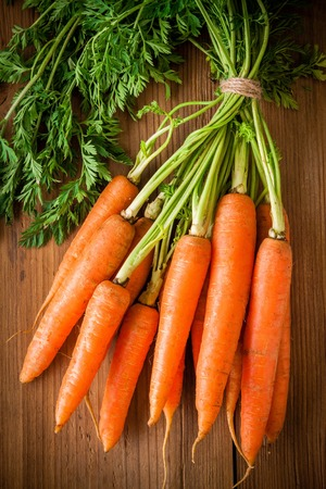 fresh carrots bunch on rustic wooden background Reklamní fotografie - 36483301