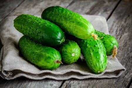 fresh organic cucumbers on rustic wooden table