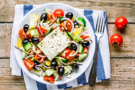 greece: Greek salad of organic vegetables with tomatoes, cucumber, red onion, olives and feta cheese Stock Photo
