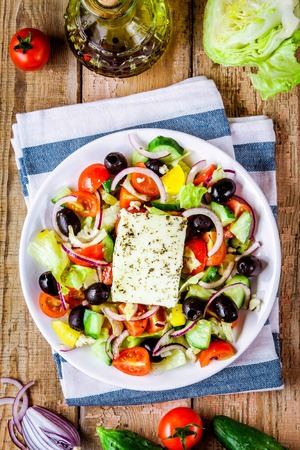 Greek salad of organic vegetables with tomatoes, cucumber, red onion, olives and feta cheese Stock Photo