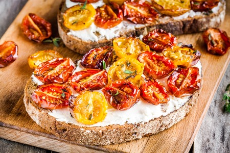 tomato: fresh bruschetta with cream cheese and sun dried tomatoes closeup