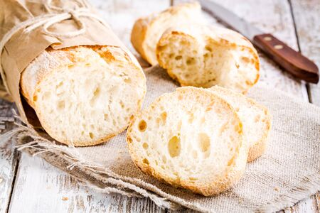 rustic food: French Baguette, baked food on white rustic table Stock Photo