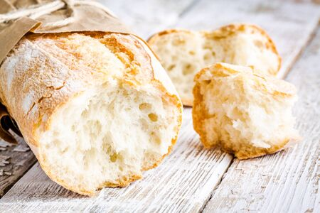 French Baguette, baked food on white rustic table photo