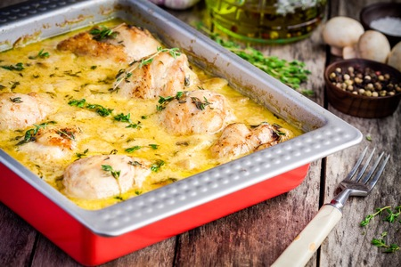 sauce dish: Baked chicken legs in mustard sauce with mushrooms in a baking dish