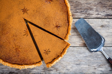 Homemade pumpkin pie on wooden rustic background top view Stock Photo
