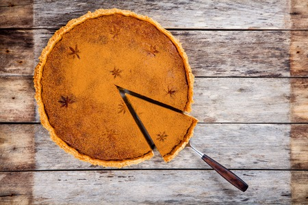 orange slice: Homemade pumpkin pie on wooden rustic background top view Stock Photo