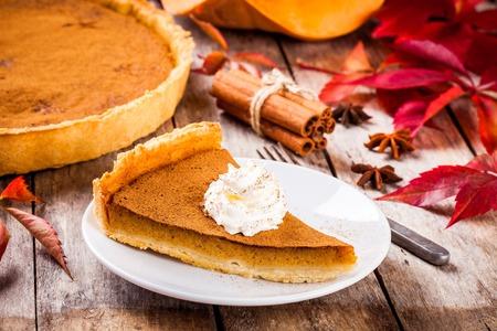 pumpkin pie: Homemade pumpkin pie on wooden rustic background selective focus
