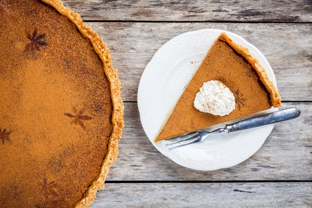 pumpkin pie: Homemade pumpkin pie on wooden rustic background top view Stock Photo