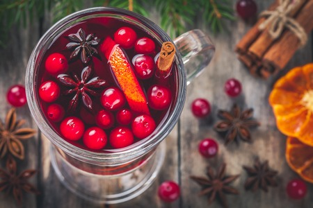 homemade style: Homemade mulled wine with orange slices, cranberries, cinnamon and anise. Retro style.