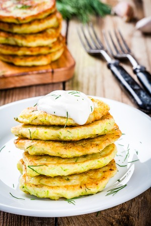 fritters: Homemade zucchini fritters with dill. Rustic style.