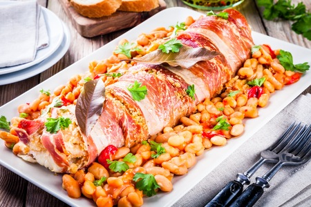 codfish: Codfish baked in a jamon with beans, baked paprika and parsley