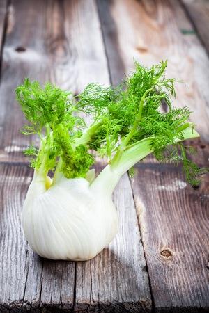 bulb and stem vegetables: Fresh organic fennel on wooden dark table
