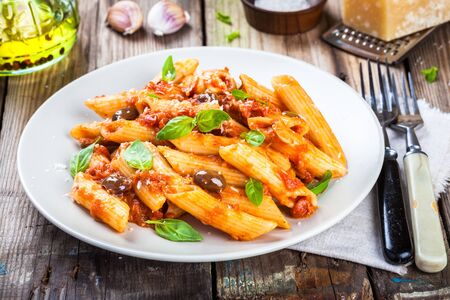 pasta: Italian penne pasta with tomato sauce, olives and basil