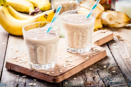 eating banana: Healthy breakfast: banana smoothie with oatmeal, peanut butter and milk Stock Photo