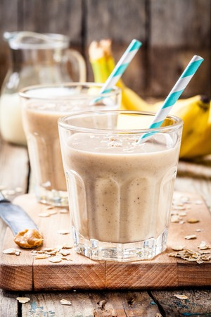 Healthy breakfast: banana smoothie with oatmeal, peanut butter and milk Reklamní fotografie