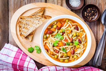 borlotti beans: Italian cuisine: minestrone soup with whole grain toasts