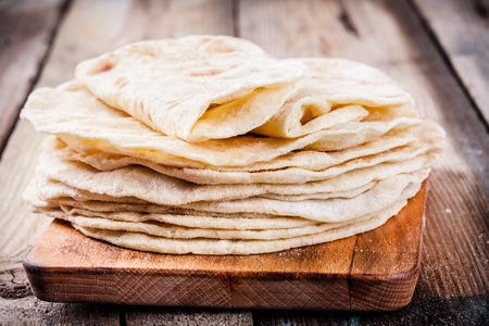 Stack of homemade wheat tortillas on wooden table Reklamní fotografie