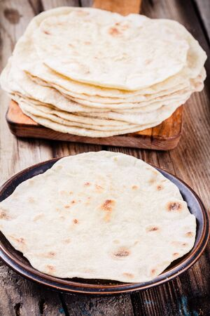 tortillas: Stack of homemade wheat tortillas on wooden table Stock Photo
