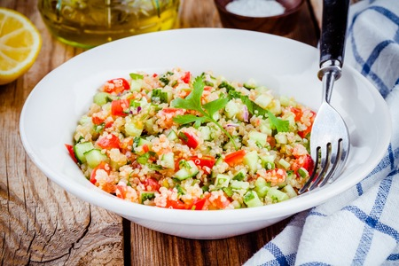 tabbouleh: homemade tabbouleh salad with quinoa, cucumber, tomato, coriander, onion and mint