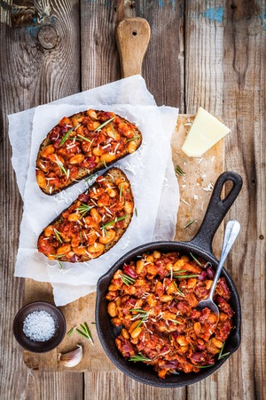 beans on toast: baked beans with tomatoes, rosemary and parmesan cheese on toast