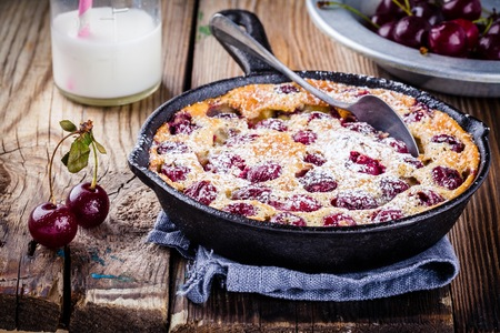Clafoutis cherry pie on rustic wooden background 스톡 콘텐츠