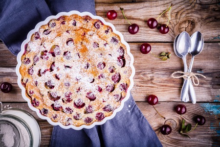 Clafoutis cherry pie on rustic wooden background Reklamní fotografie