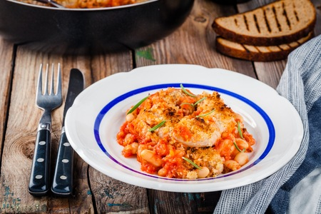 bacon baked beans: Cassoulet with sausages, beans and bread crumbs Stock Photo