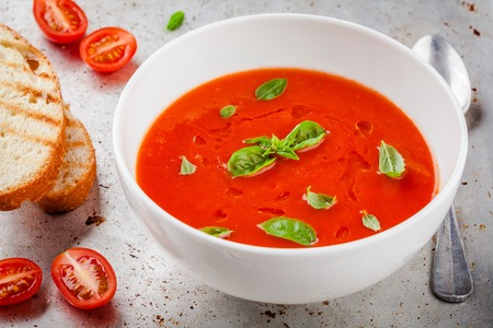 gazpacho: cold tomato soup gazpacho with basil and croutons Stock Photo