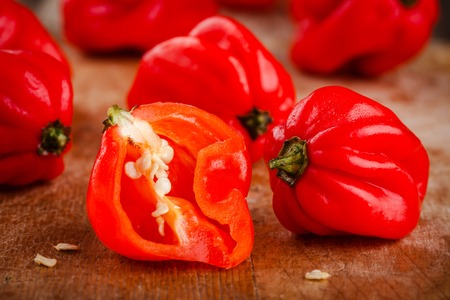 fresh red hot habanero chili peppers  on wooden background Stock Photo