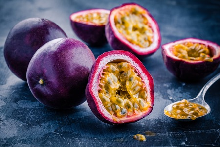ripe organic passion fruit on dark background