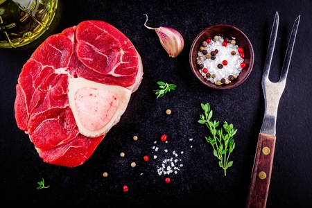 raw fresh veal shank meat for ossobuco on dark background Stock Photo - 64616624