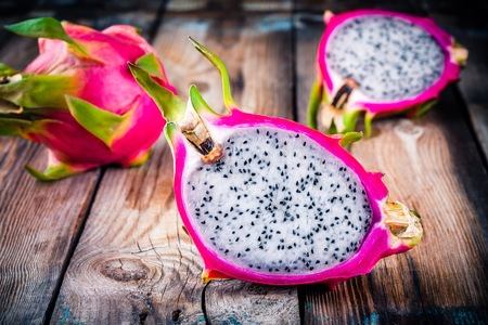 Tropical dragon fruit or pitaya on wooden rustic background
