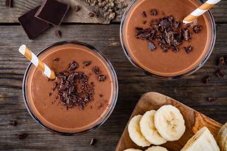 Chocolate smoothie with banana on rustic wooden background Banque d'images