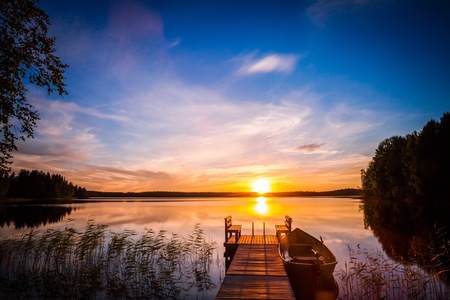 made in finland: Sunrise over the fishing pier at the lake in rural Finland